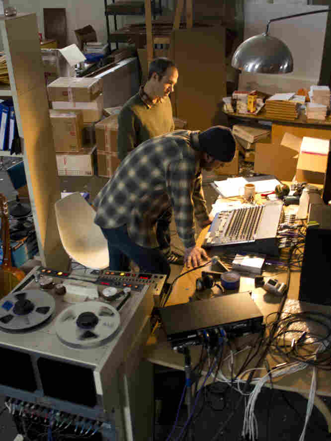 Joyner (rear) at work in his warehouse studio with guitarist Mike Friedman.