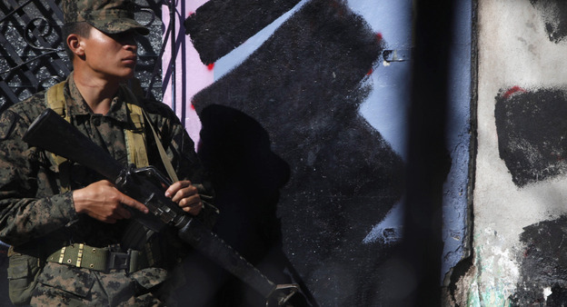 A soldier guards the area where ousted President Manuel Zelaya was kept after returning to Honduras in 2010.