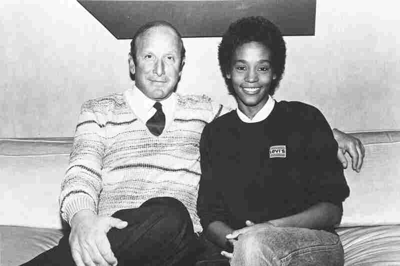Still a rising star in 1983, Houston sits with music producer and mentor Clive Davis, shortly after signing a contract with Arista Records.