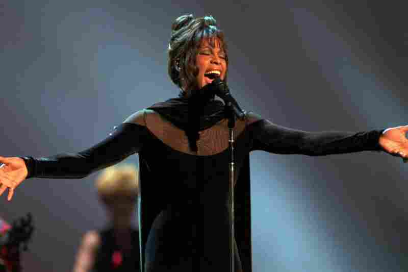 Houston performs at the 1994 American Music Awards in Los Angeles. Starring in both the movie The Bodyguard and its soundtrack, the vocalist swept the awards.