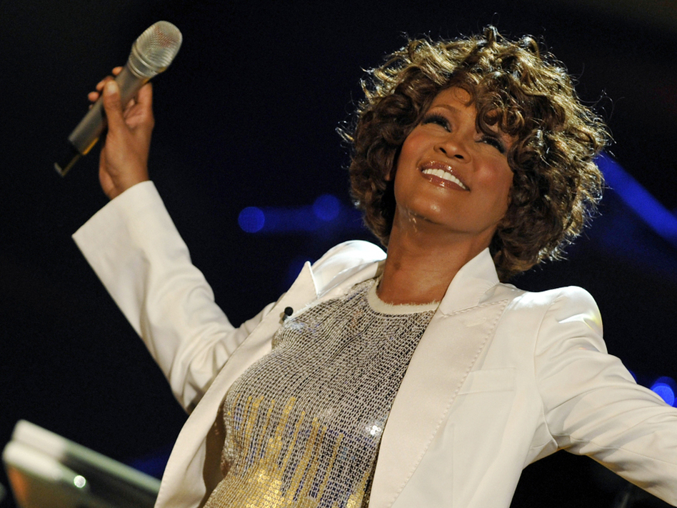 Whitney Houston performs in Germany in 2009. The singer died Saturday, leaving behind a superstar career riddled with achievements.
