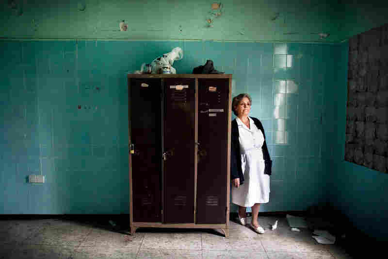 Stella Trivizaki stands near an abandoned locker at Asklypeio Public Hospital in Athens. This nurse's area was scheduled for renovation four years ago.