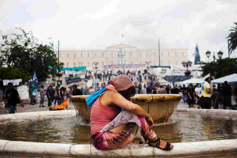 A woman recuperates in Athens' Syntagma Square after being gassed during a demonstration against austerity measures last summer.