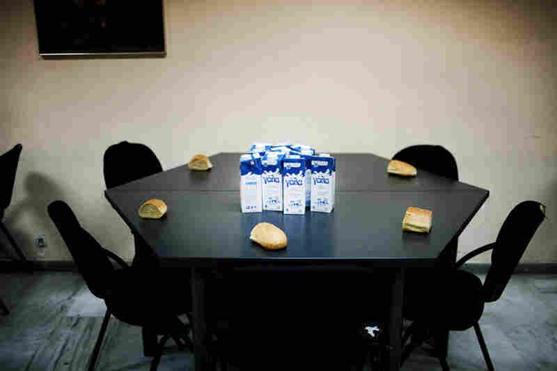 Milk and bread sit on a table at the Athenian Municipal Solidarity Center where poor families and the homeless are fed.