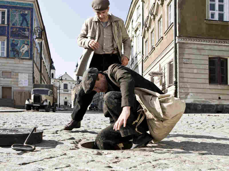 Socha (Robert Wieckiewicz, foreground, with Krzysztof Skonieczny) is portrayed as a man with mixed motivations — a hero almost in spite of himself.