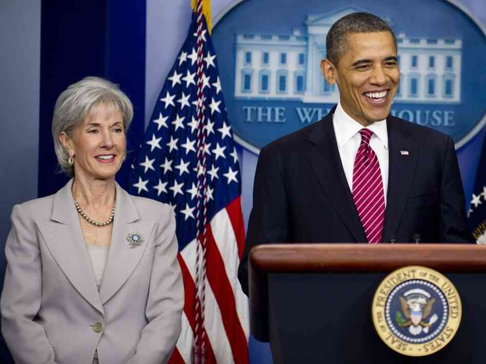Barack Obama stands with Health and Human Services Secretary Kathleen Sebelious as he announces that insurance companies and not religious employers will cover the cost of  mandated free contraceptive coverage at the White house in Washington, D.C., Feb. 10, 2012.