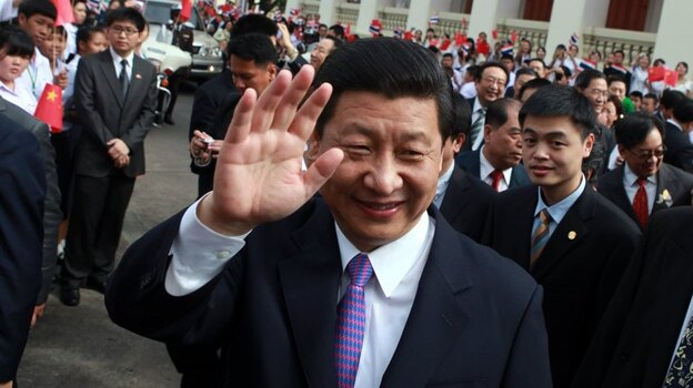 Chinese Vice President Xi Jinping, shown here in December 2011 waving to students during a visit to Bangkok, Thailand, is in line to become China's leader next year. (AFP/Getty Images)