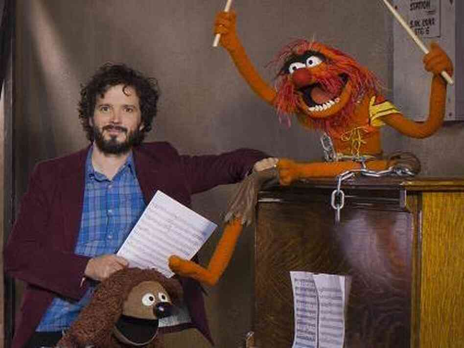 "Bret McKenzie (left) wrote five of the songs in The Muppets, including the Oscar-nominated ""Man or Muppet"" and the opening number, ""Life's a Happy Song."""
