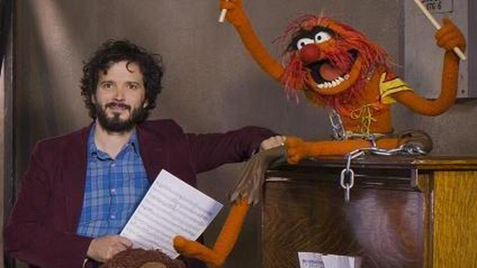 "Bret McKenzie (left) wrote five of the songs in The Muppets, including the Oscar-nominated ""Man or Muppet"" and the opening number, ""Life's a Happy Song."" (Disney)"