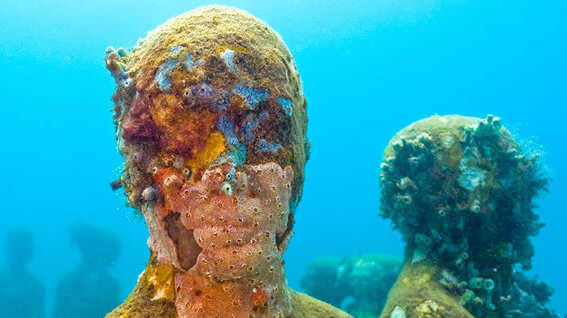 In an attempt to draw tourist from the delicate natural habitat of the coral reef, Jason de Caires Taylor constructed an underwater sculpture garden on the sea floor to help preserve the ocean complex ecosystem.