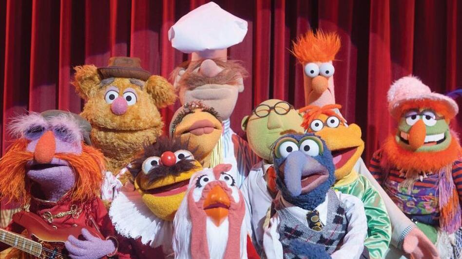 The cast of The Muppets includes (left to right) Floyd Pepper, Fozzie Bear, Lew Zealand, Janice, Swedish Chef, Camilla The Chicken, Dr. Bunsen Honeydew, Gonzo, Scooter and Beaker. (Disney)