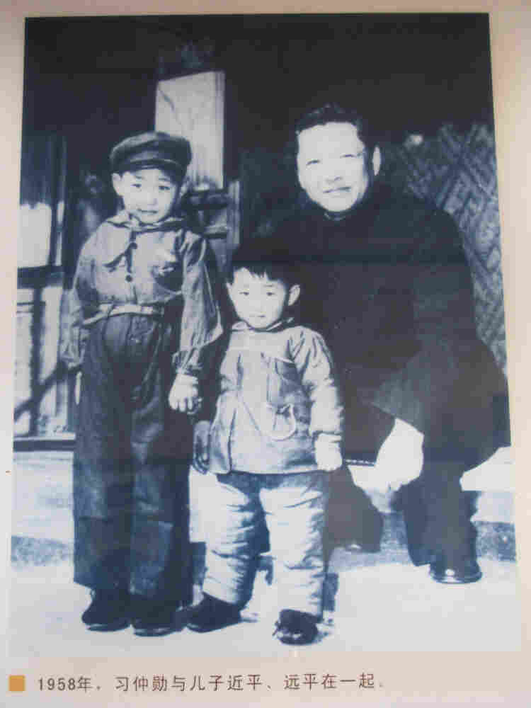 A family photograph from 1958 showing Xi Jinping (left), 5, with his brother Yuanping and father, Xi Zhongxun, is on display at a museum in Xi Zhongxun's hometown in China's Shaanxi province.