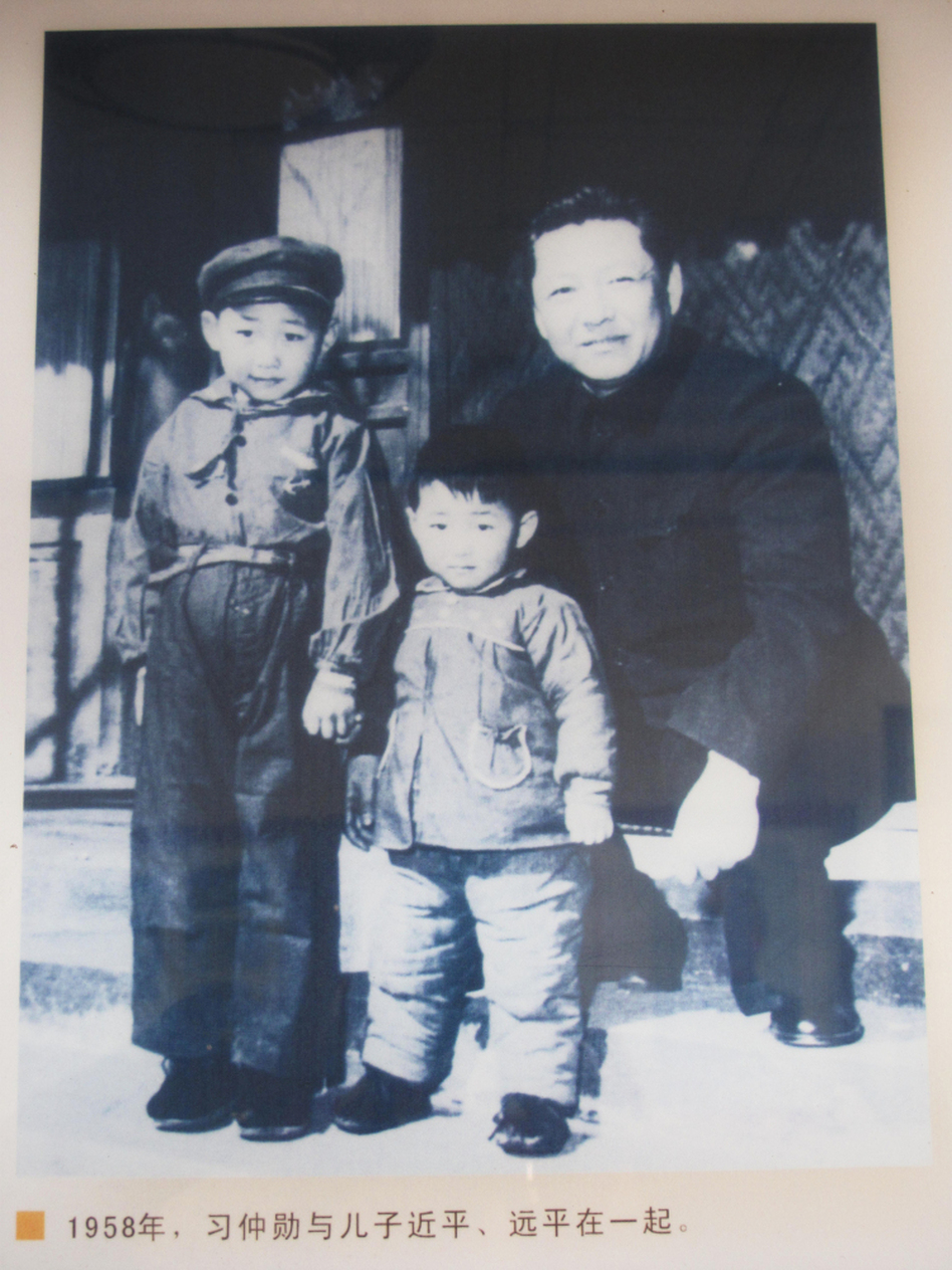 A family photograph from 1958 showing Xi Jinping (left), 5, with his brother Yuanping and father, Xi Zhongxun, is on display at a museum in Xi Zhongxun's hometown in China's Shaanxi province.  (NPR)