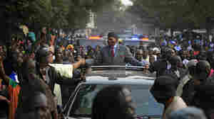 Senegalese President Abdoulaye Wade, 85, greets supporters during a campaign rally in Dakar last week. He is seeking a third term. Critics say he is violating the constitution and should step down.