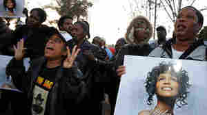 Fans attend a Whitney Houston Leimert Park Vigil on Monday in Los Angeles.