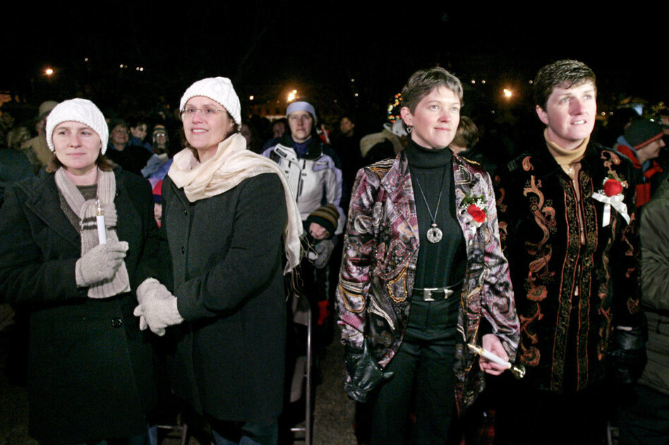 Couples Gretchen Grappone and Rose Wiant (left). and Wendy Waterstrat and Holly Henshaw hold hands before their civil union, in front of the Statehouse in Concord, N.H., on Jan. 1, 2008.