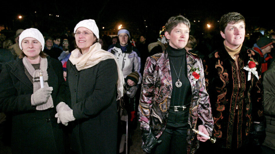 Couples Gretchen Grappone and Rose Wiant (left). and Wendy Waterstrat and Holly Henshaw hold hands before their civil union, in front of the Statehouse in Concord, N.H., on Jan. 1, 2008.  (AP)