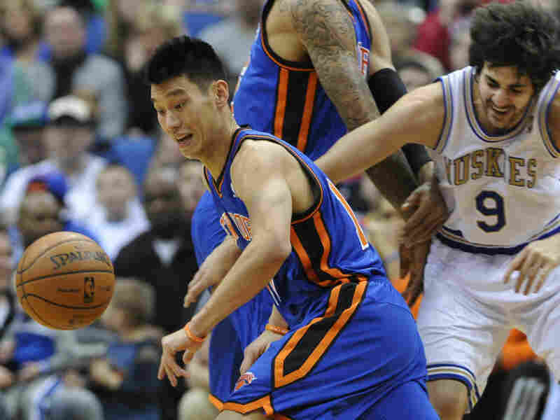 Jeremy Lin chases the loose ball in the first half of an NBA basketball game in Minneapolis. Lin is one of the few Asian-Americans in NBA history.