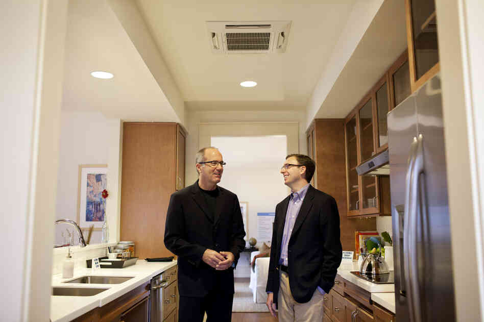 David Haygood of the IDEO design firm (left) and Casey Nolan of Clark Realty Capital worked collaboratively in the design and development of this unique housing, alongside renowned architect and designer Michael Graves. On the ceiling above Haygood and Nolan is an enhanced HVAC system, which allows for 12 temperature-controlled zones around the home.