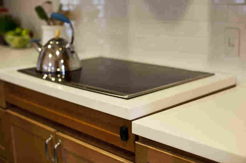 "Automatic lifts are built into countertops to adjust to different heights. ""When you are in a wheelchair, it is a game of inches,"" says Nolan, ""whether it is the width of the doorway or the height of the counter."""