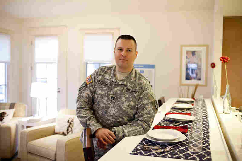 "Capt. John Votovich, Fort Belvoir's battalion operations officer, stands in the family room of the Wounded Warrior Home. ""We have more of a wounded population today that wouldn't have survived in earlier generations. They're still productive members of the military, and they will continue to be so,"" he says."
