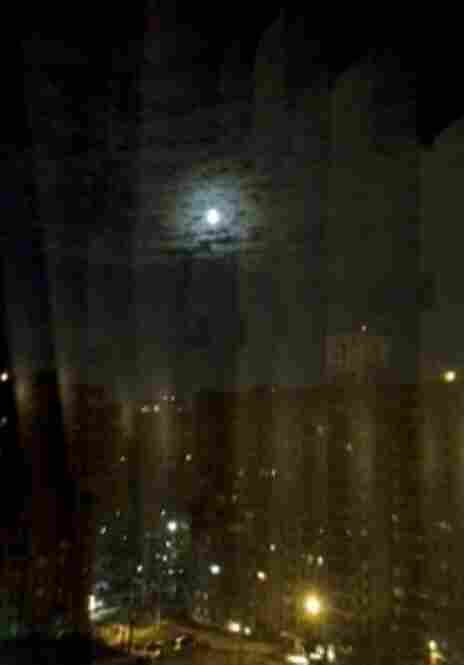 "Angela Bourelly snapped this pic during the nightshift. ""Just me, the moon and NPR,"" she writes."