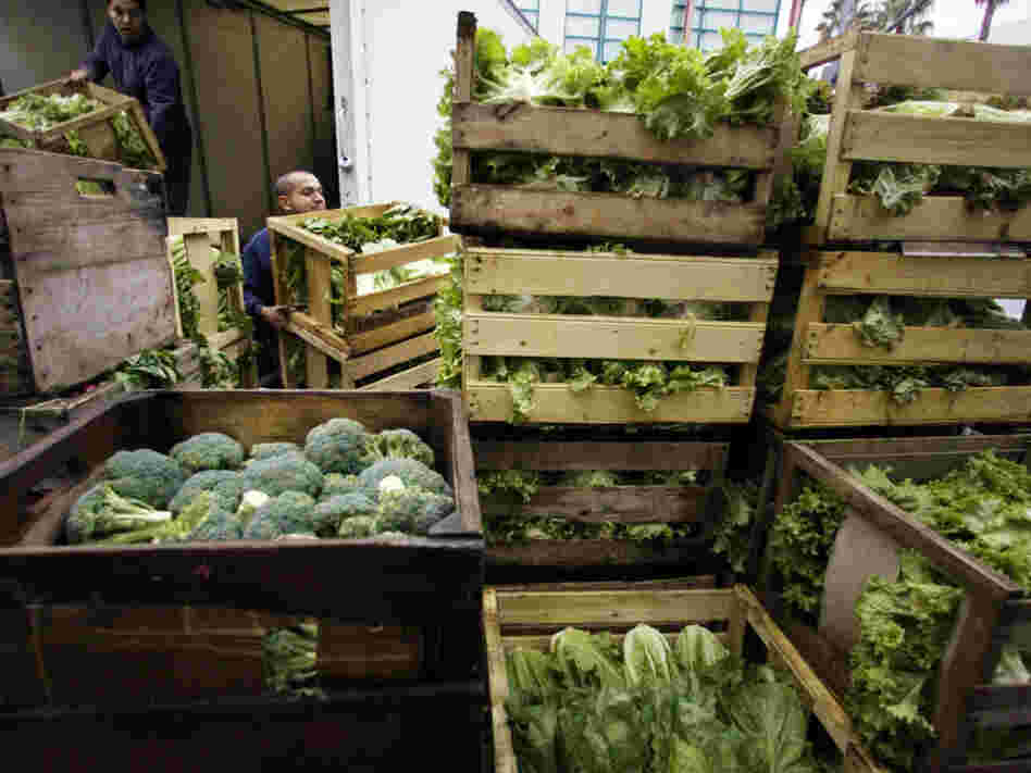Edgar Jaime (right) and his brother Jose Luis unload organic vegetables from their farm in Santa Monica, Calif. Now that U.S. and European organic standards are equivalent, more American organic farmers will be able to export to Europe.
