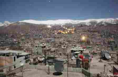 An image from the Local Coordinating Committees of Syria website shows the mountain town of Zabadani in the distance, during a barrage on Feb. 9.
