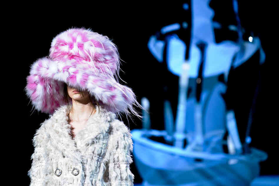"Marc Jacobs' show was a ""joyous celebration of eccentricity,"" says Sally Singer, editor at T: The New York Times Style Magazine. The set was ""Dr. Seuss-meets-Marie Antoinette paper-cut fantasy,"" and the models were a cross between ""Eliza Doolittle and Fagin's merry band."" The music was from Oliver!"