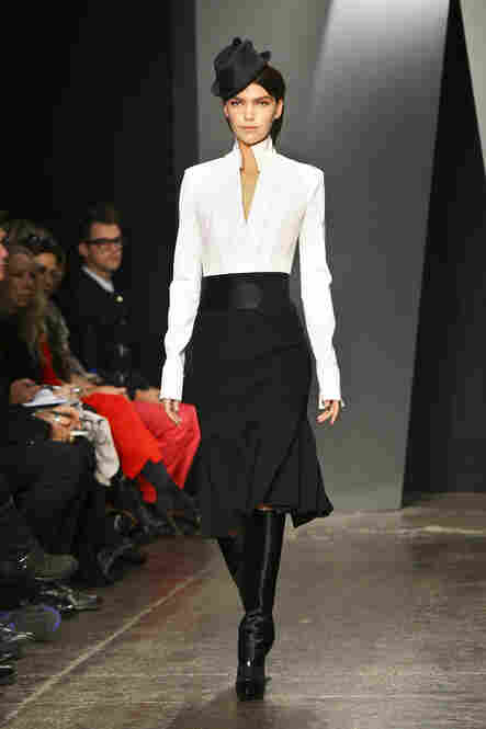 "In another return to basics, Singer says she's ""seeing designers deciding to sort of batten down the hatches and do the thing that they do best."" She points to Donna Karan's crisp white shirt and black skirt as one example of a design that's sharp and new, but not risky or daring."