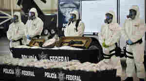 Mexican police show the drug and weapons seized from Jaime Herrera Herrera, an alleged drug cartel member, in Mexico City on Tuesday.