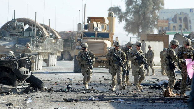 U.S. soldiers are expected to be in Afghanistan for a couple more years. But already there's a debate about future U.S. security needs worldwide. Here, soldiers examine the site of a suicide bombing in the southern Afghan city of Kandahar on Jan. 19.
