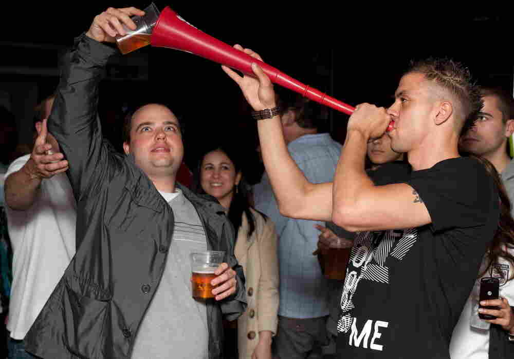 """Prime Minister David Cameron calls binge drinking """"one of the scandals of our society."""" Here, a man drinks a pint of beer through a makeshift """"Vuvuzela of Ale"""" in London, in a file photo from 2010."""