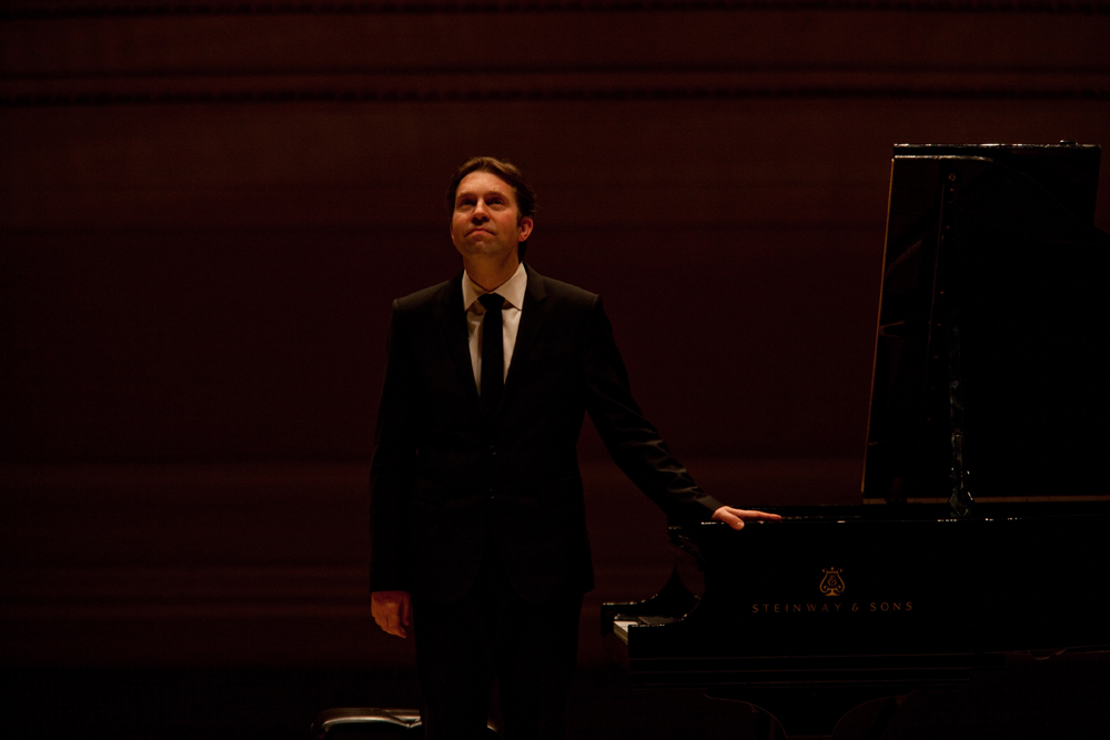 Gazing up to the balcony at Carnegie Hall, Andsnes  acknowledges the enthusiastic applause from a full house of  admirers.