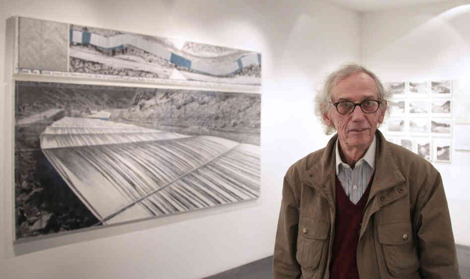 Christo stands next to one of his works at a 2010 exhibition in Paris about the Over the River project. If approved, the installation could begin in the fall.
