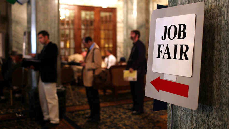 People wait in line to enter a job fair in San Francisco. Many who are unemployed avoid events like job fairs that might help them find work because of anxiety.