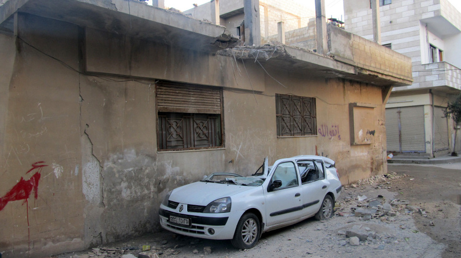 A handout picture from a Syrian opposition activist taken on Feb. 13 shows damages in the Baba Amro neighborhood in the flashpoint Syrian city of Homs. (AFP/Getty Images)