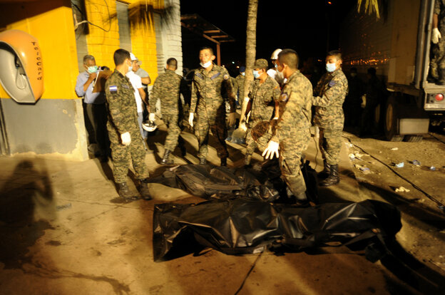 Inmates bodies are loaded in a trailer truck at the National Prison in Comayagua, north of Tegucigalpa.