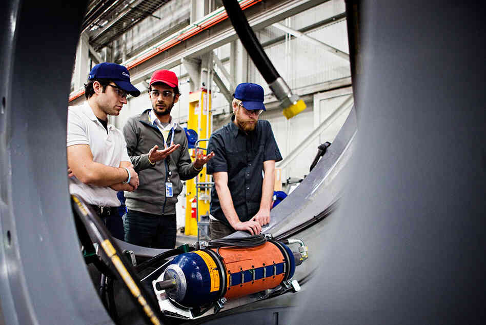 The Gamesa factory in Fairless Hills, Pa., produces nacelles for wind turbines. Nacelles house the gear box, generator, electrical transformers and wiring. From left, engineers Eric Nicosia, Amin Ahmadi and Gavin Boogs work to solve an issue with a nacelle at the factory on Feb. 10.