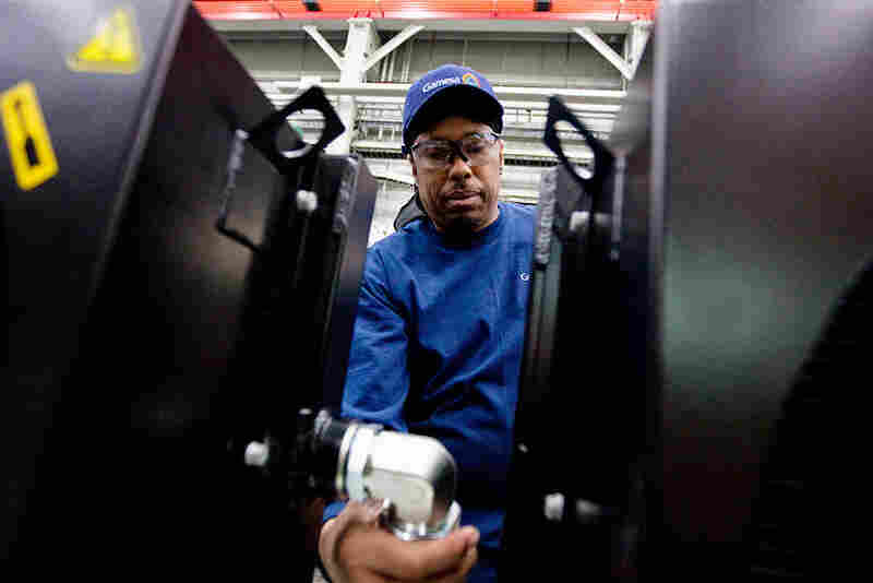 "About 175 people work at Gamesa's factory, including Jerry ""Jazz"" Holt, who is assembling an oil cooler unit."