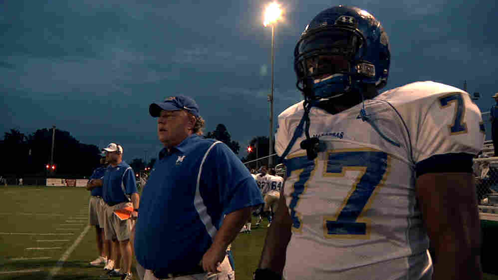 North Memphis' Manassas Tigers Coach Bill Courtney and player O.C. Brown stand on the sidelines in a scene from the Oscar-nominated documentary Undefeated.