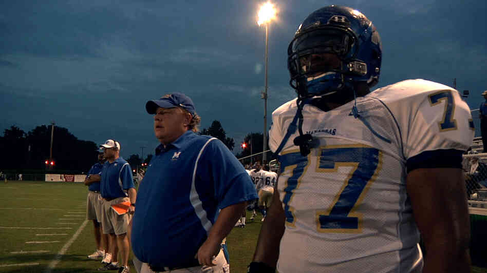 North Memphis' Manassas Tigers Coach Bill Courtney and player O.C. Brown stand on the sidelines in a scene from the Oscar-nominated docu