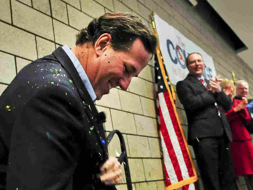 """Republican presidential candidate Rick Santorum brushes off glitter after being """"glitter-bombed"""" before a campaign rally on Feb. 7 in Blaine, Minn."""