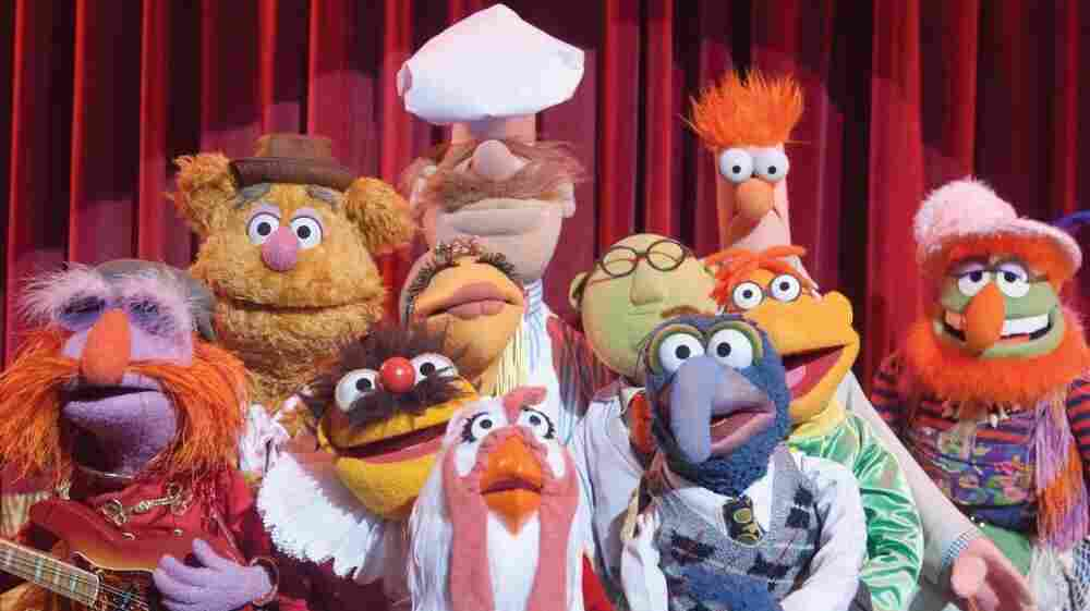 The cast of The Muppets includes (left to right) Floyd Pepper, Fozzie Bear, Lew Zealand, Janice, Swedish Chef, Camilla The Chicken, Dr. Bunsen Honeydew, Gonzo, Scooter and Beaker.
