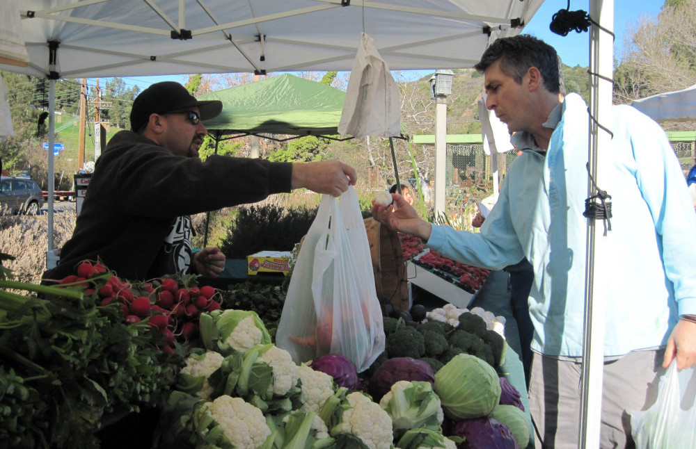 "Life is a ""collection of extraordinarily ordinary moments,"" Payne says. ""We just need to pay attention to them all."" Above, Payne stops at a farmers market near his home in the Santa Monica Mountains."
