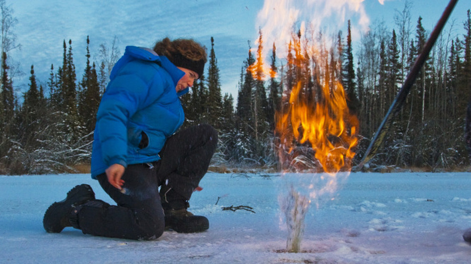 A new program led by the U.S. seeks to limit amounts of soot, hydrofluorocarbons and methane   released into the atmosphere. In this file photo from 2009, a researcher ignites trapped methane from under a pond's ice cap in Alaska.