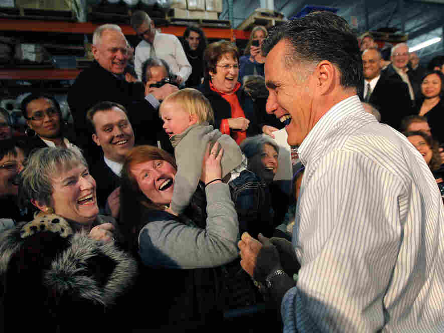 Mitt Romney laughs with supporters at a rally in Kentwood, MI, Wednesday, Feb. 15, 201