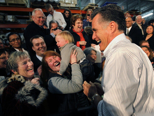 Mitt Romney laughs with supporters at a rally in Kentwood, MI, Wednesday, Feb. 15, 2012.