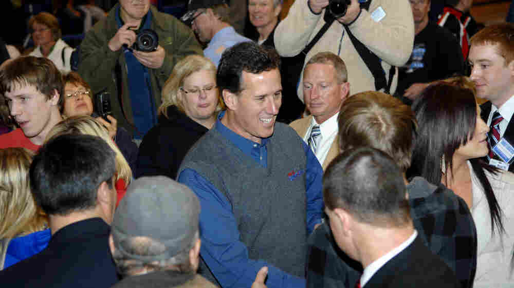 Republican presidential candidate, former Pennsylvania Sen. Rick Santorum works the crowd at the Tioga Public School on Wednesday in Tioga, N.D.