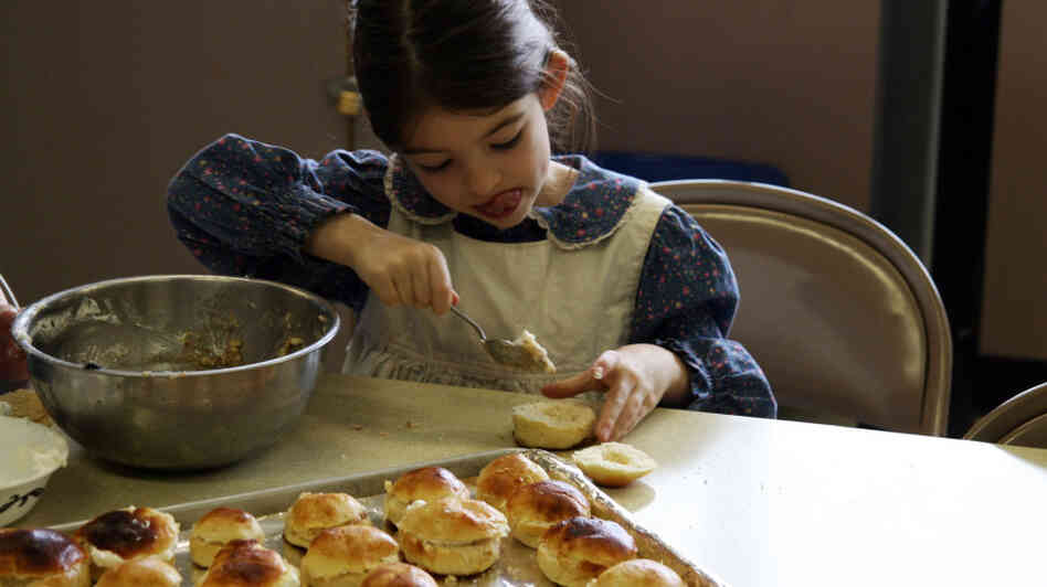 Filling semlor with sweet almond paste requires great concentration from Astrid Foster, age 7. Get the recipe for semlor.